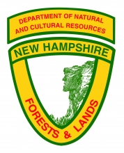 The logo of the NH Division of Forests and Lands is a yellow and red badge.