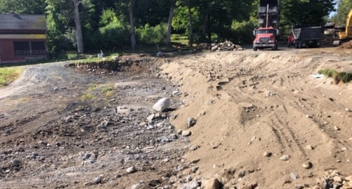 Construction equipment works on moving dirt at the site of the historic Tool Building at The Rocks.