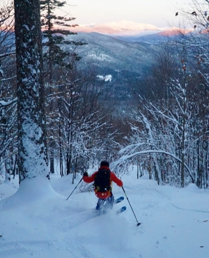 Skiing down the East Branch glade in the White Mountains with views of Mt. Washington