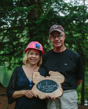 """Land Stewards John and Jackie Stetser say """"vigilance"""" is the best word to describe the way they and their neighbors keep a watchful eye on the property they steward."""