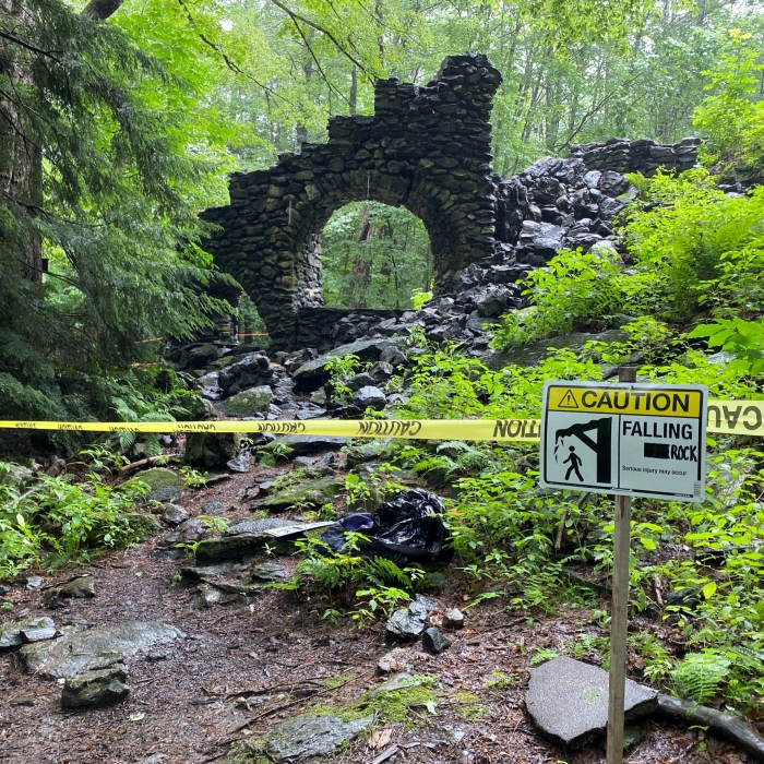 Caution tape surrounds the ruins of Madame Sherri's castle, some of which recently fell.