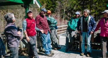 Staff member, Carrie Deegan with volunteers at Lost River, North Woodstock, NH.