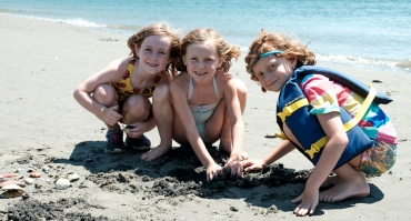Gundalow Company Campers play in the sand along Sagamore creek