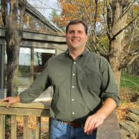 Brian Hotz poses outside of the Conservation Center in autumn.