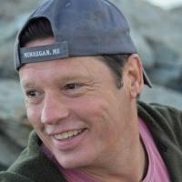 A headshot of Phil Stone.