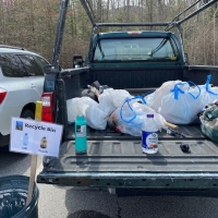 A Forest Society truck is partially full of bags of trash collected on Mount Major.
