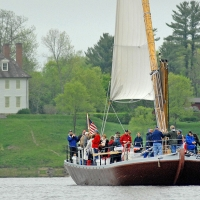 A gundalow sails near Creek Farm.
