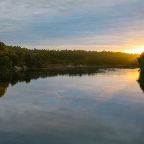 The sun sets over the Merrimack River near the Forest Society's conservation area.