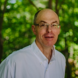 A headshot of Matt Leahy outside at the Conservation Center.